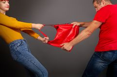Robber takes bag. The girl is trying to prevent the robber who wants to pull the bag out of her hands royalty free stock images