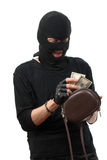 Robber takes money from stolen handbag. Royalty Free Stock Image