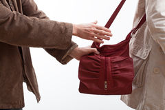 Robber taking a woman purse Royalty Free Stock Photography