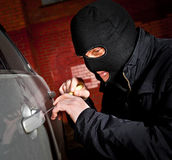 Robber and the thief in a mask hijacks the car Royalty Free Stock Image