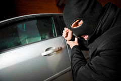 Robber and the thief in a mask hijacks the car Royalty Free Stock Photography