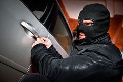 Robber and the thief in a mask hijacks the car Royalty Free Stock Photos