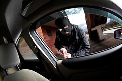 Robber and the thief in a mask hijacks the car Royalty Free Stock Images