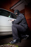 Robber and the thief in a mask hijacks the car Stock Photography