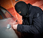 Robber and the thief in a mask hijacks the car Stock Photos
