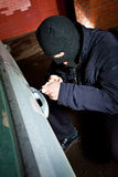 Robber and the thief in a mask hijacks the car Stock Images