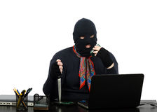 Robber threatening by cell phone Stock Images