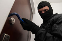 Robber Tries To Break In Stock Image