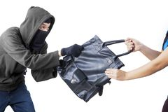 Robber trying to snatch a handbag from his victim Royalty Free Stock Photos
