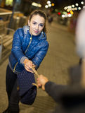 Robber trying to steal bag at night Stock Photos