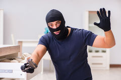 The robber wearing balaclava stealing valuable things Royalty Free Stock Photos