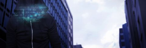 Composite image of robber wearing black hoodie. Robber wearing black hoodie against high angle view of crowded buildings in city Stock Photography