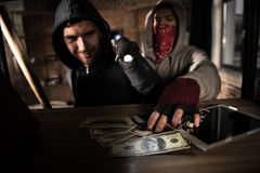 Robbers stealing money stock photography