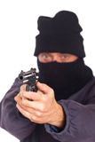 Robbery. Thief Aiming a Gun on a Robbery Stock Photography