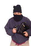 Robbery. Thie Aiming a Gun on a Robbery Stock Photography