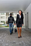 Robbery concept. Bandit in mask following businesswoman. Robbery concept Royalty Free Stock Photos