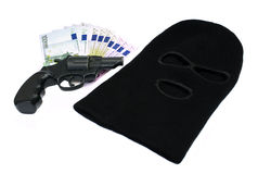 Robbery evidence. Robbery, theft concept: thief mask, revolver gun and euro money evidence royalty free stock images