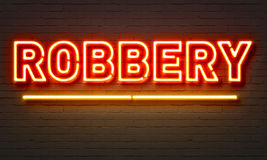 Robbery neon sign on brick wall background. Robbery neon sign on brick wall background Royalty Free Stock Photography