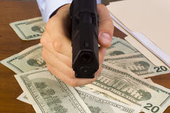 Robbery. With the use of a gun Stock Photo