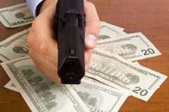 Robbery. With the use of a gun Royalty Free Stock Image