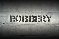 Robbery WORD GR. Robbery stencil print on the grunge white brick wall Royalty Free Stock Images