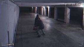 Robbing a girl in an underpass. Recording from a surveillance camera. View of dangerous situation in the underpass stock video