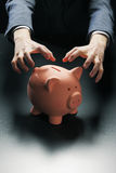 Robbing the Piggy Bank royalty free stock photo