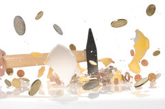 Robbing the piggy bank. Robbing breaking the piggy bank with hammer Stock Images