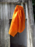 A monks robe hanging on a rope Stock Photography