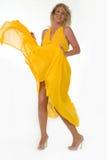 Robe jaune de soufflement Images libres de droits