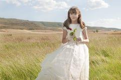 Robe s'usante de communion de fille première photo stock