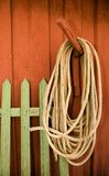 Robe wood and colour. Rope hanging on the wooden red wall Royalty Free Stock Photos