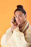 Robed Asian Man Stock Photo