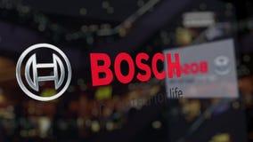 Robert Bosch-GmbHlogo auf dem Glas gegen unscharfes Geschäftszentrum Redaktionelle Wiedergabe 3D lizenzfreie abbildung