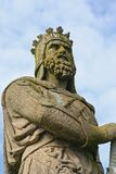 Robert the Bruce. Statue of King Robert the Bruce in Stirling, Scotland with castle in background stock photography