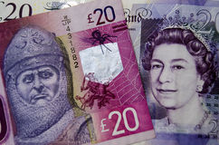 Robert the Bruce and Queen money. BASINGSTOKE, UK - SEPTEMBER 14, 2014:  Banknotes for £20 issued by the Clydesdale Bank and the Bank of England.  One shows Stock Photography