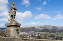 Robert the Bruce statue in Stirling, Scotland. Robert the Bruce statue with Stirling and Wallace Monument in the background, Scotland Stock Photos