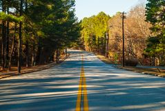 Robert E Lee Boulevard in Stone Mountain Park, Georgia, USA. Robert E Lee Boulevard with long shadows of trees in the Stone Mountain Park in sunny autumn day stock photography