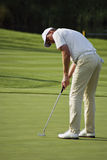 Robert Karlsson sinks his putt Royalty Free Stock Image