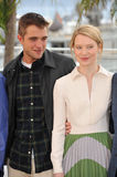 Robert Pattinson & Mia Wasikowska. CANNES, FRANCE - MAY 19, 2014: Robert Pattinson & Mia Wasikowska at the photocall for their movie Maps to the Stars at the Royalty Free Stock Image