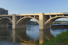 Robert Street Bridge and Barge. Robert Street bridge spanning Mississippi River in Saint Paul Minnesota stock photo