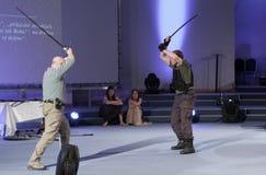 Robert Waschka κατά τη διάρκεια της συζήτησης για το στρατιώτη εναντίον του πολεμιστή σε Anime Στοκ Φωτογραφίες
