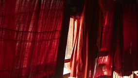 The robes of Buddhist monks hanging stock video
