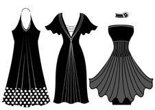 Robes de femme de mode. Isolant noir de silhouette de vecteur Images libres de droits