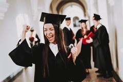 Robes. Graduate. Asian Girl. Cheerful. Standing royalty free stock photo