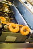 Robić donuts Fotografia Royalty Free