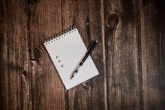 Robić liście w notatniku obraz stock