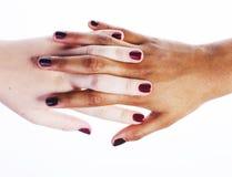 Robić manikiur ręki na biały odosobnionym, afrykanin z caucasian zakończeniem up, podłączeniowi różnorodni ludzie pojęć Obrazy Stock