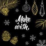 Robi życzeniu! Wręcza pisać bożego narodzenia doodle na czarnym tle i literowanie Zdjęcie Royalty Free