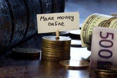 Robi pieniądze online Zdjęcia Stock
